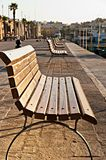 Bench on promenade at sunrise Stock Photography