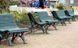 Bench in public garden Stock Photos