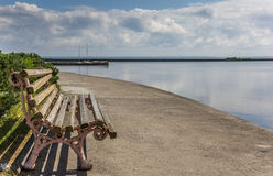 Bench at the quay on Curonian Spit Stock Photography