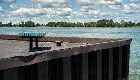 Bench on a Quay. Beside the Saint Lawrence seaway Stock Photo