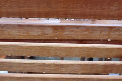 Bench after the rain with water droplets stock images