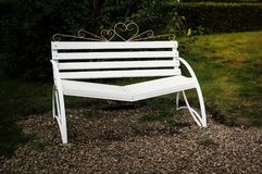 Bench of reconciliation. White bench in the Park in the evening stock photos