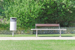 Bench and recycle bin. In the park Stock Photos
