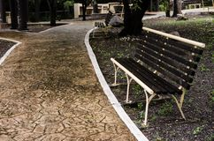 bench on a red brick road in a beautiful outdoor park stock photography