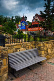 Bench and red-roofed buildings in Helen, Georgia. Royalty Free Stock Photography