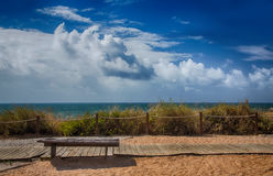 Bench for relaxation by the ocean stock photos
