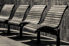 Bench rest people light sun iron wood Royalty Free Stock Photo