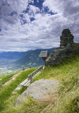 Bench by the ridge path Royalty Free Stock Image