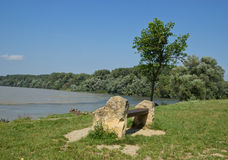 Bench on River Shore Royalty Free Stock Photography
