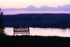 Bench on the riverside at night Royalty Free Stock Photos
