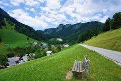 Bench on the road to Zgornja Sorica in Upper Carnolia. Slovenia stock image