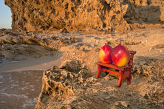 The Bench on the Rock. Two peaches on the bench at the rock royalty free stock photos