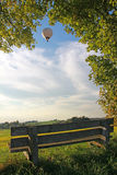 Bench in rural landscape, balloon Royalty Free Stock Photos