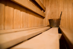 Bench in sauna and copper bucket Royalty Free Stock Images