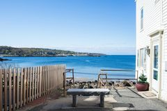 Bench with scenic view in the alley. Bench with sea view at Rockport, MA Royalty Free Stock Photos