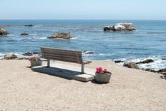 Bench by the sea Stock Photography