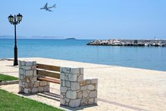Bench by the Sea and Airplane Royalty Free Stock Photos