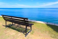 Bench on sea beach Royalty Free Stock Image
