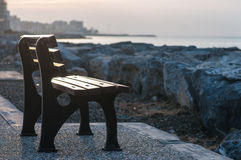 Bench by the sea Stock Images
