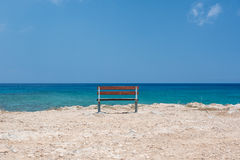 Bench at the sea. Empty bench at the crystal clear sea Royalty Free Stock Photography