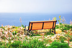 Bench at the sea Stock Photography