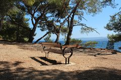 Bench by the sea - summer photo Stock Images