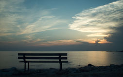 Bench by the sea at sunset. In Croatia - Umag Stock Image