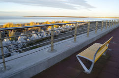 A bench on a sea wall Stock Photography