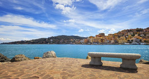 Bench on seafront in Porto Santo Stefano, Argentario, Tuscany, I Royalty Free Stock Image