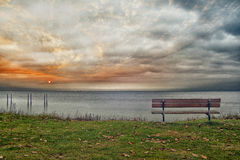 Bench and seascape by the sea Stock Photography