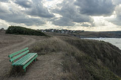 A Bench on the Seashore Stock Image