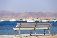 Bench on seashore Royalty Free Stock Photography