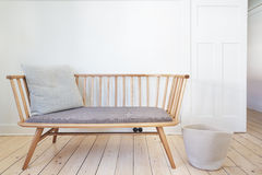 Bench seat feature chair in Danish styled interior. Bench seat feature chair in Danish styled white interior Stock Images