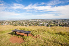 Bench seat from top of Mount Eden for looking over Auckland's c Stock Image