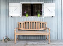 A bench seat on the veranda of a traditional house Royalty Free Stock Images