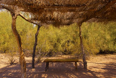 Bench in the Shade of a Desert Ramada Royalty Free Stock Photography