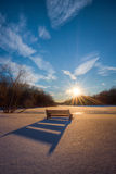 Bench shadow in fresh snow. Nearing sunset it casted a shadow of a bench on fresh snow Royalty Free Stock Photo