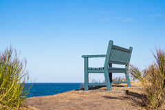 A bench on shore of the Baltic Sea.  stock photo