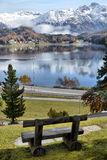 Bench on the shore of an lake. Bench on the shore of an alpine lake Royalty Free Stock Image