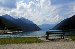 Bench on the shore of a lake Royalty Free Stock Photo