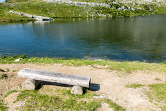 Bench at the shore of the lake Stock Photos