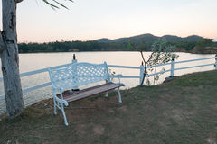 The bench on side of Lake in Thailand,process color. Royalty Free Stock Image