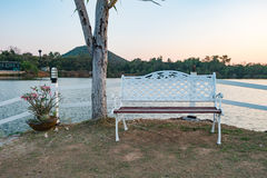 The bench on side of Lake in Thailand,process color. Royalty Free Stock Photography