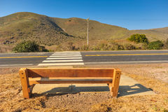Bench by the side of a road Royalty Free Stock Photography