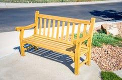 Bench on Sidewalk Royalty Free Stock Image
