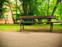 Bench on sidewalk walking pavement in park. landscape. Royalty Free Stock Photos