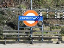 Bench and sign at Chorleywood railway station royalty free stock photography