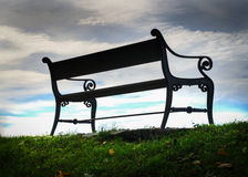 Bench silhouette. Bench in a park towards blue sky royalty free stock image