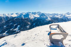 Bench in ski resort Bad Gastein in winter snowy mountains, Austria, Land Salzburg Royalty Free Stock Photos