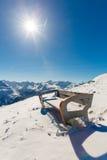 Bench in ski resort Bad Gastein in winter snowy mountains, Austria, Land Salzburg Stock Photo